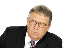 Stern Businessman. Stern middle aged businessman looks to camera left Stock Photography