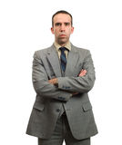 Stern Businessman. A young businessman with his arms crossed is giving a stern look Stock Photos