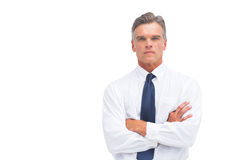 Stern businessman with crossed arms Stock Photography