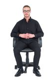 Stern businessman sitting on an office chair Stock Photography