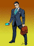 Stern businessman with smartphone Royalty Free Stock Images