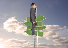 Stern businessman standing on ladder Stock Photography
