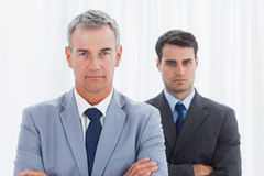 Stern businessmen posing crossing arms Stock Photo
