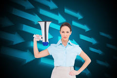 Stern classy businesswoman holding megaphone Stock Images