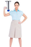 Stern classy businesswoman holding megaphone. While posing on white background Stock Photography