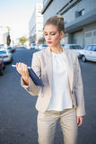 Stern classy businesswoman holding tablet computer Stock Photo