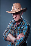 Stern cowboy. Standing with arms crossed Royalty Free Stock Image
