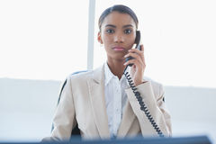 Stern elegant businesswoman on the phone Stock Photos