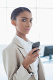 Stern elegant businesswoman text messaging Royalty Free Stock Photos