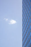 Stern facade of office building and one cloud Royalty Free Stock Photo