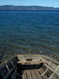 Stern. Feed the old boat isolated on the background of the blue mountains and water Royalty Free Stock Photography