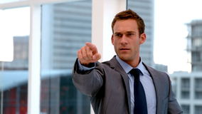 Stern handsome businessman pointing ahead stock footage