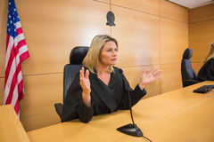 Stern judge speaking to the court Royalty Free Stock Image