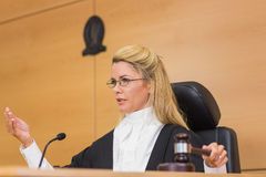 Stern judge speaking to the court Stock Image
