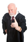 Stern Judge Wags Finger. Stern old judge wags his finger as he lays down the law.  Isolated on white Stock Photo