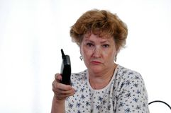 Stern Look. A woman points a telephone with a stern look Royalty Free Stock Photo