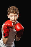 Stern look the boy in gloves Royalty Free Stock Images