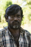 Stern-looking Tamil man. Stock Photo