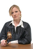 Stern looking woman judge. Blond stern looking caucasian woman judge holding a gavel over white background royalty free stock images
