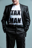 Stern man wearing a Tax Man t-shirt Royalty Free Stock Images