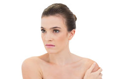 Stern natural brown haired model looking away Royalty Free Stock Image
