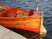 Stern of an old wooden boat. With a wooden rudder, tied to a dock Stock Photo