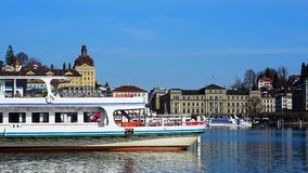 View of a passenger ship and the city of Lucerne in the background stock image