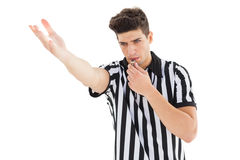 Stern referee blowing his whistle Stock Photography