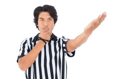 Stern referee blowing his whistle Royalty Free Stock Photography