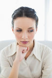 Stern stylish brunette businesswoman posing looking away Stock Images