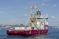 Stern view of drilling vessel Dina Polaris returning to New Bedf. New Bedford, Massachusetts, USA - June 22, 2018: Geotechnical drilling vessel Dina Polaris Royalty Free Stock Photo