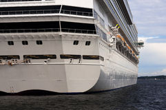 A stern view of a large cruise ship in port. Horizontal view Royalty Free Stock Photo