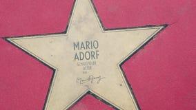 Stern von Mario Adorf At Boulevard-der Sternen, Weg des Ruhmes in Berlin stock footage