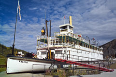 Stern-wheeler SS Keno, Dawson City. The SS Keno, now resting on the riverbank of Dawson City, Canada, carried silver, lead and zinc ore on the Yukon River. 1960 royalty free stock photo
