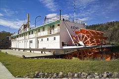Stern-wheeler SS Keno, Dawson City. The SS Keno, now resting on the riverbank of Dawson City, Canada, carried silver, lead and zinc ore on the Yukon River. 1960 royalty free stock photos