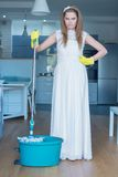 Stern Woman Wearing Gown and Holding Mop Stock Photography