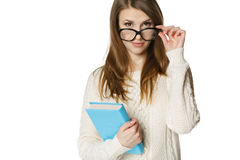 Stern young woman looking over top of eyeglasses Royalty Free Stock Image