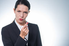 Stern young woman making a finger gesture Stock Photo
