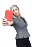 Stern young woman showing a red card Stock Images