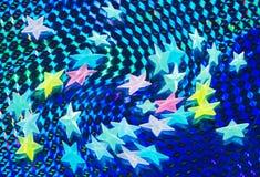 Sterne über glänzendem blauem Hintergrund Lizenzfreie Stockfotografie