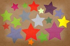 Sterne auf einem Papiergrunge Hintergrund. Stockbilder