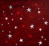 Sterne auf rotem Papier Lizenzfreie Stockfotos