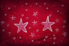 Sterne auf rotem Papier Stockbilder