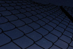 Sterne durch das Eisengitter Stockfotos