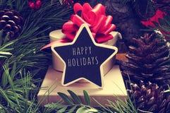 Sternförmige Tafel mit dem Text frohe Feiertage Lizenzfreies Stockfoto