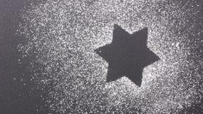 Sternform mit Zucker Stockfotografie