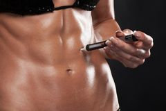 Steroids concept. Muscular woman shot on black injecting steroids stock photos