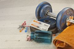 Steroids, muscle-building, dangerous sport. Sports fraud royalty free stock photo