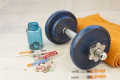 Steroids, muscle-building, dangerous sport. Sports fraud royalty free stock photography