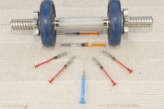 Steroids, muscle-building, dangerous sport Stock Photos